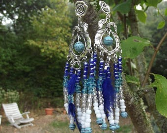 long earrings with feather