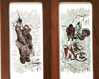 Two, mid-century ceramic plaques featuring Canadians fishing and with their dogs and sled.