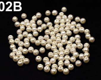 05-A - 50 g of beads 6 mm mother of Pearl round glass