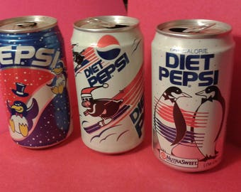 Vintage Pepsi and Diet Pepsi soda cans with penguins