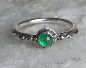 Sterling Silver Water Band set with an Emerald