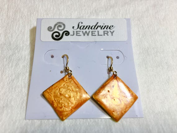 Handmade small diamond shape orange enamel gold plated earrings with abstract designs