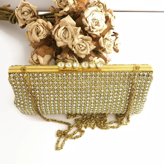Vintage rhinestone purse with gold engine turned frame with 6 enormous rhinestones on top, long link chain handle, circa 1960s