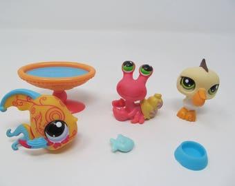 Littlest Pet Shop - 6 Pieces included - Hermit Crab, Pelican, Fish, Accessories