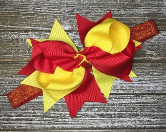 Red and yellow bow on adjustable headband