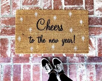 Cheers to the new year-doormat- doormats-welcome mat-shop josie b-cheers-welcome