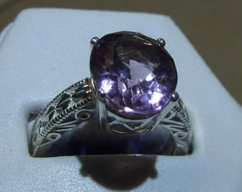 Amethyst Sterling Silver Ring - thick band so lots of silver - size 7 - stone is 12mm X 10mm - 5.2 ct