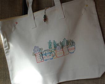 Tote bag embroidered with a colorful row of potted succulents