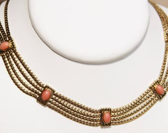 bib necklace in vermeil and genuine pink coral 4 rows, mounted on hand