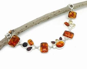10% Amber garnet and citrine multistone bracelet set in sterling silver (92.5). natural authentic stones. adjustable length lobster clasp.