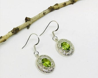 10% Peridot earrings set in sterling silver (92.5). Genuine natural faceted peridot stones. Perfectly matched stones.