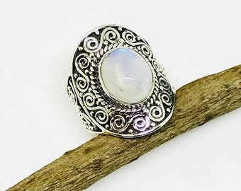 10% Rainbow Moonstone Ring set in sterling silver 92.5. Stone size- 10x12mm oval.Ring size -7. Natural authentic rainbow moonstone .