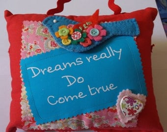 Small Cushion with saying Dreams really do come true