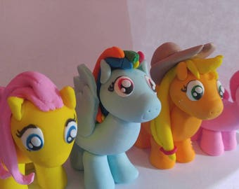 My little pony SALE!! 25 dollars for 4 pony sale!! fluttershy, pinkie pie, Applejack and rainbow dash cake fondant toppers. Ready to ship