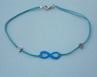 anklet with neon blue infinity sign