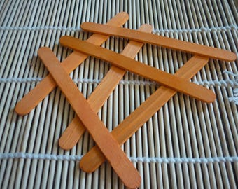 Ice orange wood stick handpainted, sold in sets of 6.