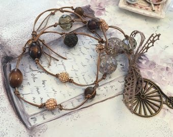taupe lace bicycle necklace
