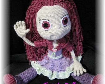 large articulated crochet purple doll.