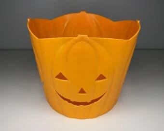 vintage plastic bucket with jack-o-lantern faces