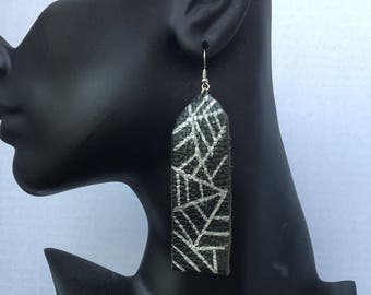 Black leather with silver design