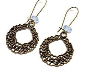 Floral sleeper earrings and blue bead
