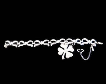 Vintage Signed Monet Silver Tone Link Bracelet with a Shamrock/Four Leaf Clover Dangle - Vinage Monet, Vintage Bracelets, Lucky Jewelry
