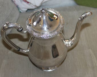 This is a Vintage Tea Set w Creamer, Sugar Bowl and Tea Pot, Coffee as Well, Silver on Copper, by Queen Bess, Tudor Plate, Onein Community