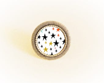 Adjustable silver ring and pendant stars on white background