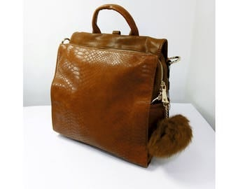 "Camel color backpack / bag with ""POM POM"" accessory"