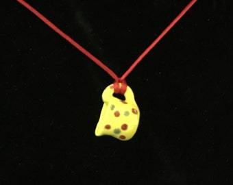 """Take a pitcher wherever you go with this yellow """"pint-sized"""" ceramic poke-a-dot pitcher necklace."""