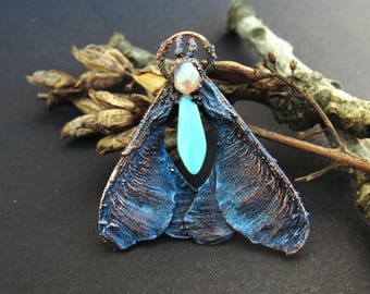 copper maple moth magic blue pendant with glass drop