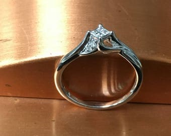 ONE 10k white gold promise ring with 4 princess cuts