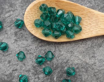 Beads faceted 4 mm, dark green glass beads
