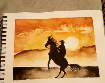 Cowboy on a dark horse.  Desert. Original watercolor