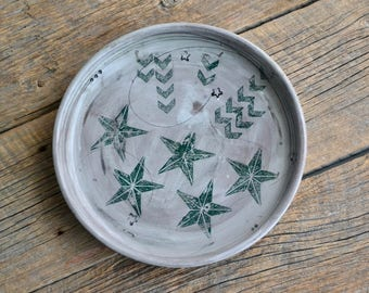 Large handmade pottery serving bowl or plate with stars and lines