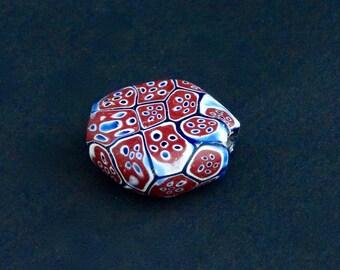 V92- An antique tabular millefiori bead