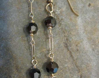 Black faceted glass and gold filled drop earrings.