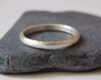 Silver very fine ring with a sandblaster effect.