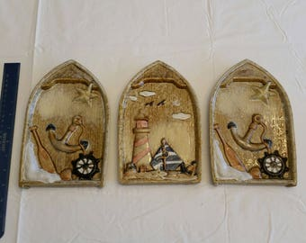 set of 3 wall hanging ceramic rowboat plaques - glazed pottery art - nautical vintage lighthouse anchor fishing starfish ocean boats beach