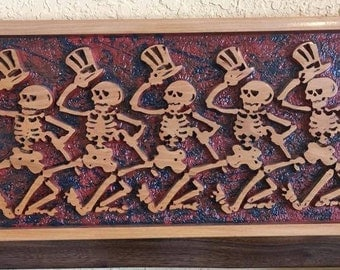 carved wooden dancing skeletons