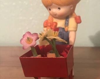 Enesco Country Cousins Figurine - Katie Pushing Her Cart Of Flowers