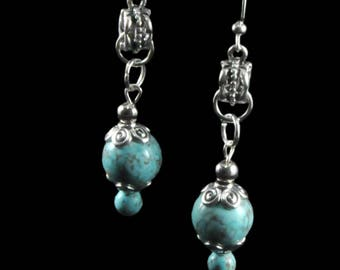 Turquoise dyed reconstituted stone and silver plated earrings