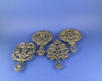 Vintage Cast Iron Trivets with feet: set if four made in the 1970's Taiwan.. kitchen decor