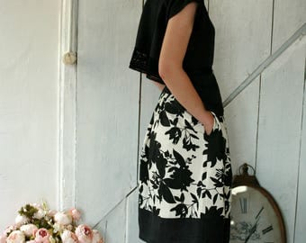 Black linen top with open back, ribbon waist and lace hemline
