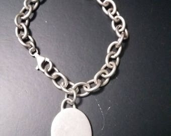 Vintage sterling silver starter charm bracelet with one oval charm