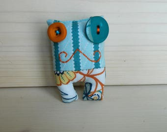 Lavandillo brooch with mustache and flower pants