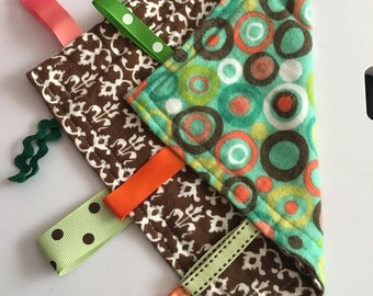 Multicolored polka dots with brown demask back lovie