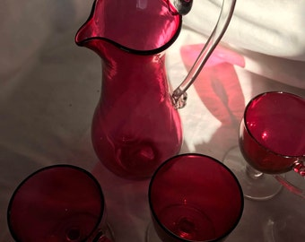 Antique Cranberry Ewer and three cups. Cranberry Glass