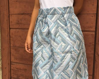 Pleated skirt in vintage blue and silver brocade.