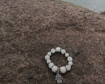 White crystal beaded bracelet with hamsa charm and marble accents